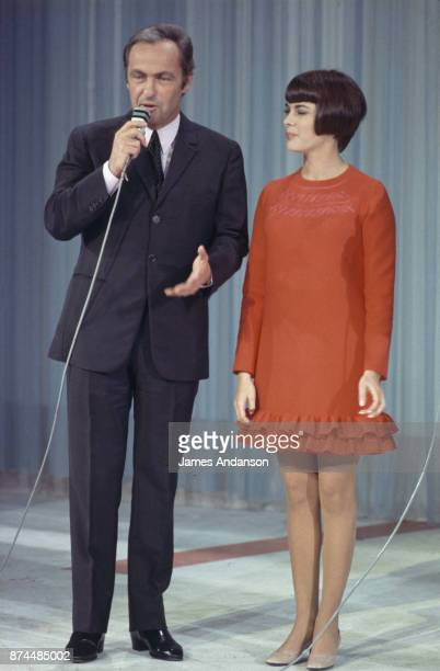 French singer Mireille Mathieu on stage with tv host Guy Lux Paris 9th october 1968
