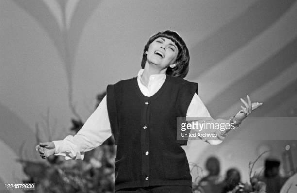 French singer Mireille Mathieu performing on German TV, Germany circa 1981.