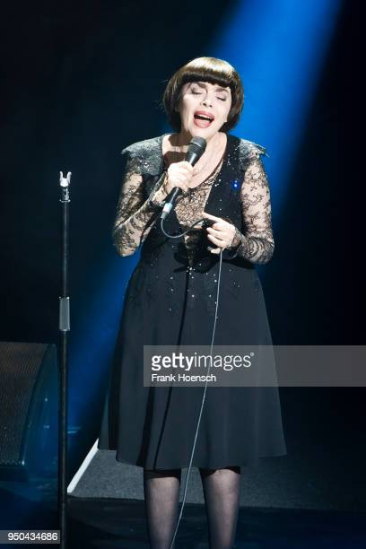 French singer Mireille Mathieu performs live on stage during a concert at the Friedrichstadtpalast on April 23, 2018 in Berlin, Germany.
