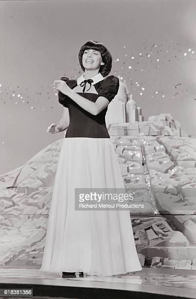 French singer Mireille Mathieu performs on the television program Numero 1. Mathieu was a popular entertainer in the 1960s and 1970s.