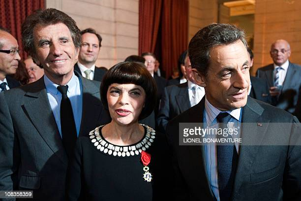"French singer Mireille Mathieu smiles after being awarded ""Officier de la legion d'honneur"" by French President Nicolas Sarkozy , next to socialist..."