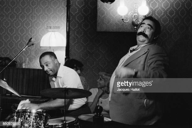 French singer Moustache and jazz drummer Kenny Clarke on stage at Bilboquet