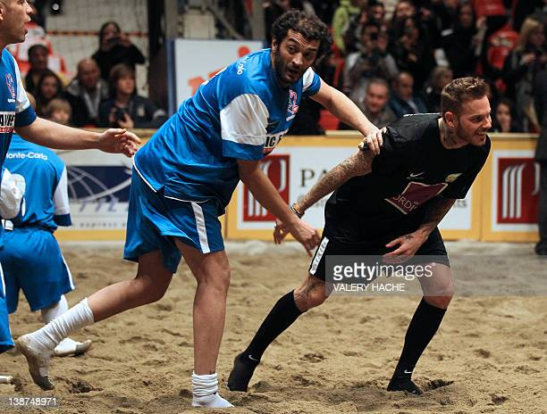 French singer MPokora and French humorist Eric Ramzi play during a charity beach soccer match on February 11 2012 in Monaco as part of the Show Beach...