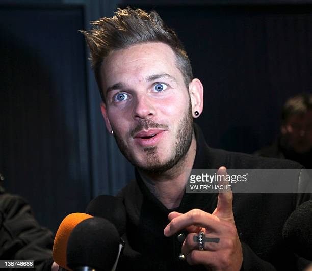 French singer MPokora answers journalists' questions on February 11 2012 in Monaco as part of the Show Beach Soccer Celebrities' Tournament The event...