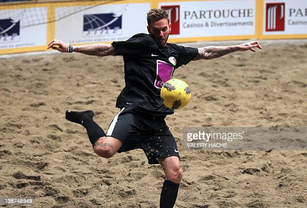 French singer MPokora controls the ball during a charity beach soccer match on February 11 2012 in Monaco as part of the Show Beach Soccer...
