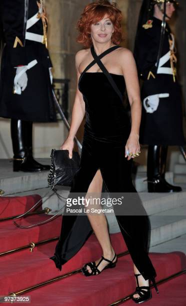 French Singer Mylene Farmer arrives to attend a state dinner honouring visiting Russian President Dmitry Medvedev at the Elysee Palace on March 2...