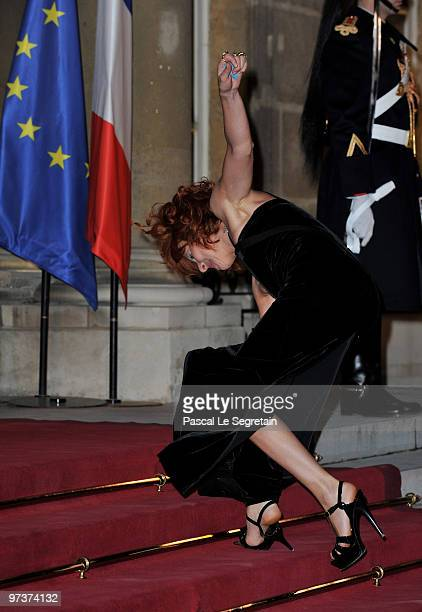 French Singer Mylene Farmer trips on the steps as she arrives to attend a state dinner honouring visiting Russian President Dmitry Medvedev at the...