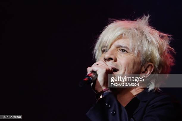 French singer Nicolas Sirkis from French rock band Indochine celebrates after receiving the 'French variety music' award during the SACEM Grand Prix...