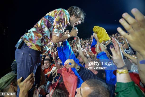 French singer of indie pop group Phoenix Thomas Mars interacts with fans as he performs on stage during the 29th Eurockeennes rock music festival on...