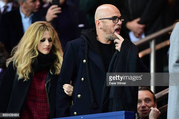 French singer Pascal Obispo and his wife Julie Hantson during the French Ligue 1 match between Paris Saint Germain and Lyon at Parc des Princes on...
