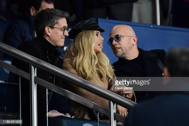 French singer Pascal OBISPO and his wife Julie HANTSON during the Champions League match between Paris Saint Germain and Club Bruges at Parc des...
