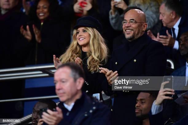 French singer Pascal Obispo with his wife Julie Hantson during the Ligue 1 match between Paris Saint Germain and Olympique Lyonnais at Parc des...