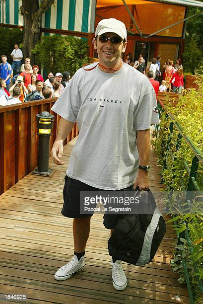 French singer Patrick Bruel arrives for the French Tennis Open at the village of Roland Garros June 2 2002 in Paris France