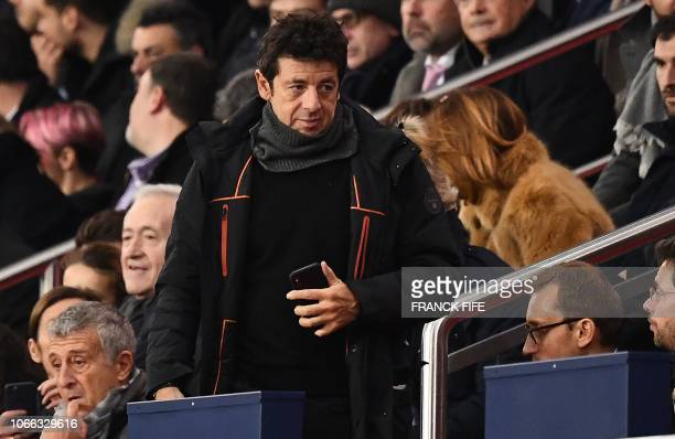 French singer Patrick Bruel arrives for the UEFA Champions League Group C football match between Paris SaintGermain and Liverpool FC at the Parc des...