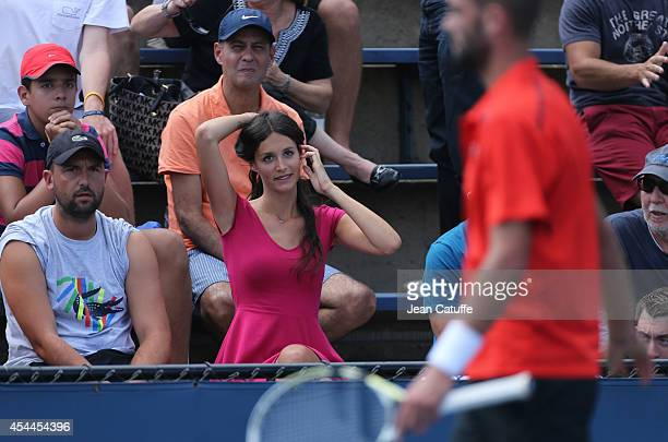 French singer Pauline Vasseur watches the match between Benoit Paire of France and Pablo Carreno Busta of Spain on Day 4 of the 2014 US Open at USTA...