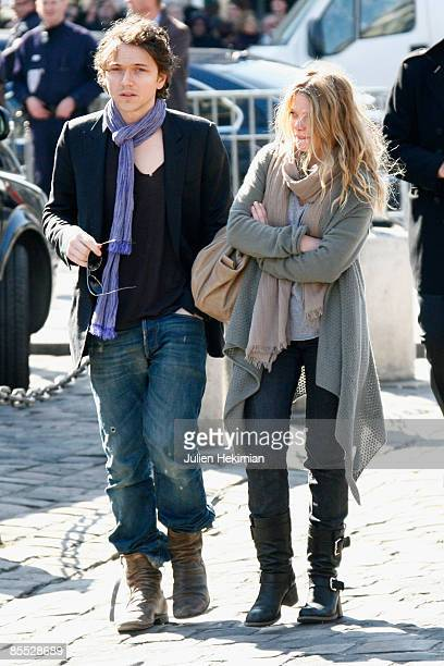 French singer Raphael and actress Melanie Thierry leave the SaintGermaindesPres church after a funeral mass for French singer and composer Alain...