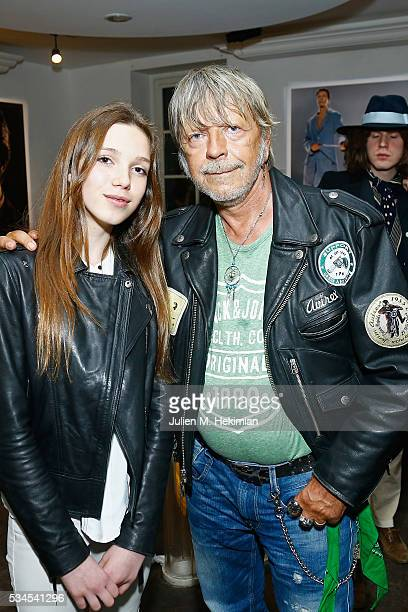French singer Renaud and Gabrielle Gervoson attend the David Bowie Unseen By Markus Klinkoon Exhibition Opening at Artcube Galery on May 26 2016 in...