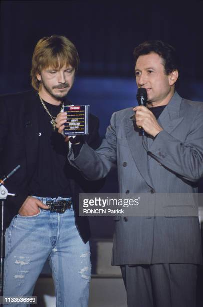 French singer Renaud and TV host Michel Drucker on the set of the TV show Stars 90