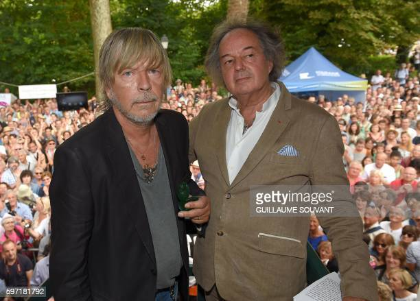French singer Renaud Séchan and French writer Gonzague SaintBris pose during the 21th book fair La Foret Des Livres on August 28 2016 in...
