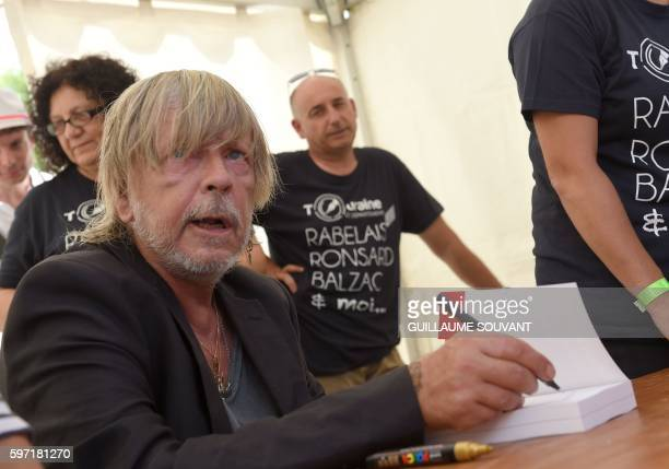French singer Renaud Séchan signs an autograph during the 21th book fair La Foret Des Livres on August 28 2016 in ChanceauxprèsLoches central France...