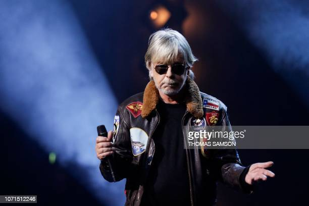 French singer Renaud Sechan aka Renaud celebrates after receiving the 'Sacem special award' during the SACEM Grand Prix awards ceremony on December...