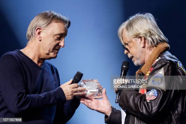 French singer Renaud Sechan aka Renaud receives the 'Sacem special award' handed over by his brother David Sechan during the SACEM Grand Prix awards...