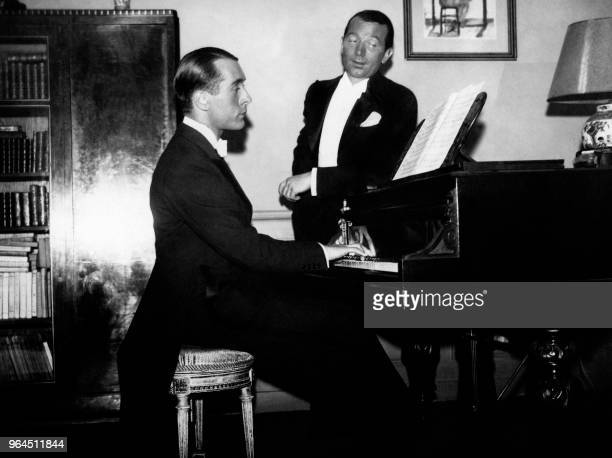 French singer Robert Burnier sings accompanied by French composer Claude Pingault at the piano in 1934