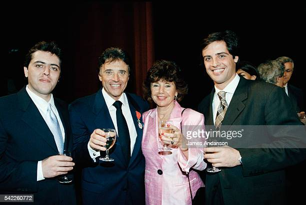 French singer Sacha Distel celebrates his Légion d'Honneur with his wife Francine and sons Julien and Laurent at the Olympia in Paris