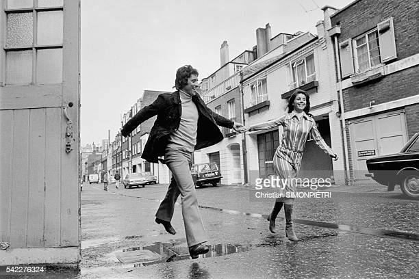 French singer Sacha Distel in London with his wife Francine Breaud