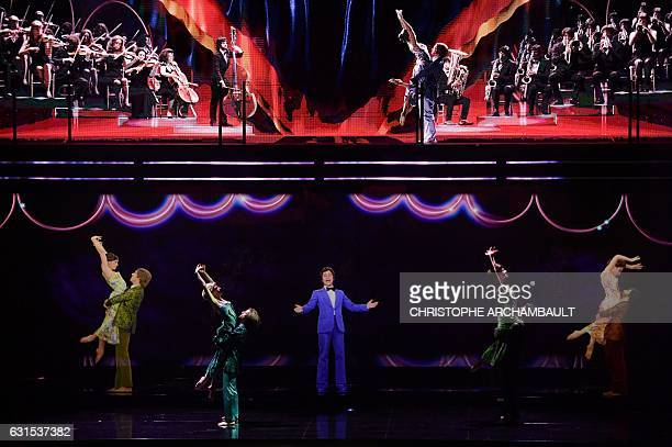 French singer Sacha Distel is seen performing during the rehearsal for the Hit Parade hologram show on January 11 2017 at the Palais des Congres in...