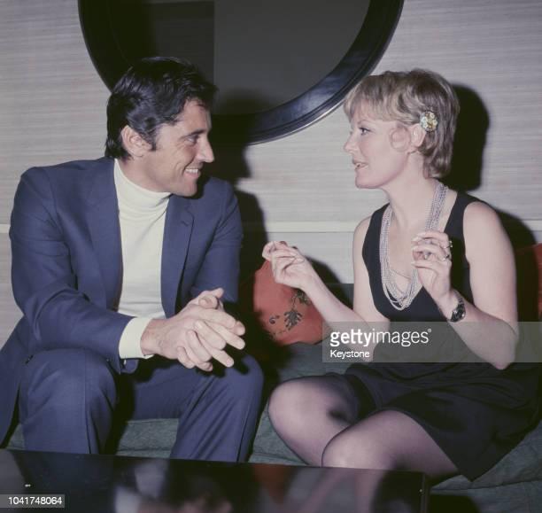 French singer Sacha Distel with British singer Petula Clark in London, circa 1970.