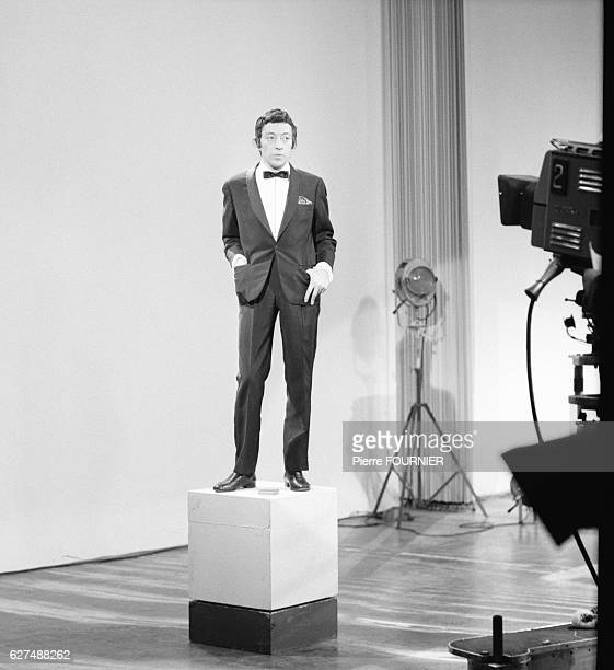French singer Serge Gainsbourg on television set.