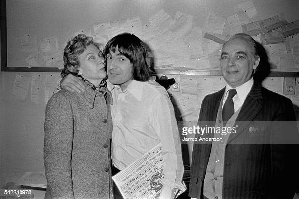 French singer Serge Lama celebrates his 34th birthday and is congratulated backstage by his parents after his show at the Palais des Congrés