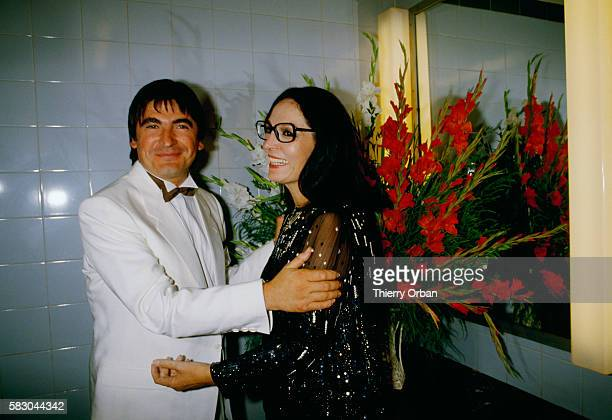 French singer Serge Lama congratulates popular Greek singer Nana Mouskouri during her 1984 concert at the Odeion of Herodes Atticus in Athens The...