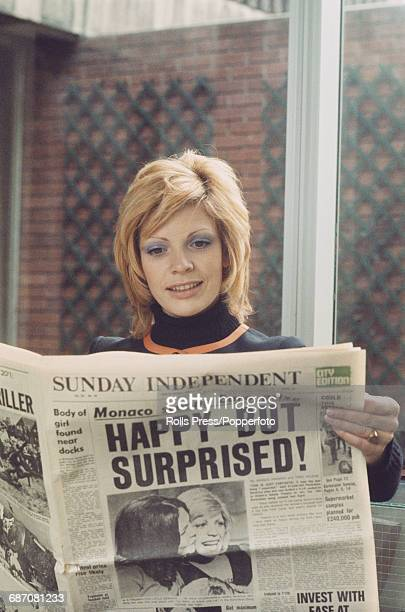 French singer Severine reads the Sunday Independent newspaper in her hotel on 4th April the day after she won the 1971 Eurovision Song Contest with...