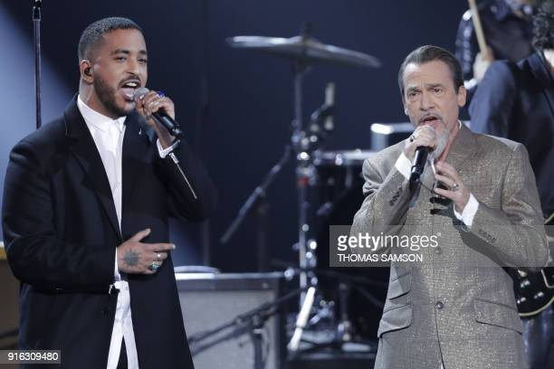French singer Slimane Nebchi aka Slimane and French actor and singer Florent Pagny perform on stage a song dedicated to late French singer Johnny...