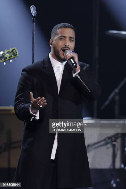 French singer Slimane Nebchi aka Slimane performs on stage a song dedicated to late French singer Johnny Hallyday during the 33rd Victoires de la...