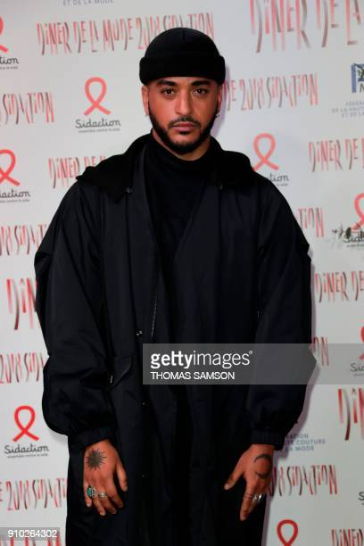 French singer Slimane poses upon arriving to the Diner de la Mode fundraiser dinner to benefit the French antiAIDS association Sidaction on January...