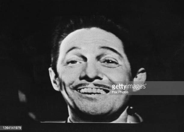 French singer songwriter and actor Jean Sablon as seen during the first crosschannel television transmission from France broadcasting to the United...