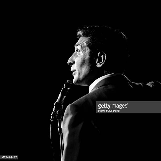 French singer songwriter pianist and actor Gilbert Becaud during his first recital at the Olympia