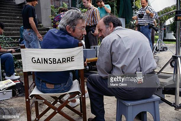 French singer songwriter screenwriter actor and director Serge Gainsbourg and his producer and actor Claude Berri on the set of his film Stan the...