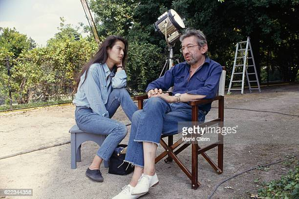 French singer songwriter screenwriter actor and director Serge Gainsbourg and his partner Eurasian singer and model Bambou on the set of his film...