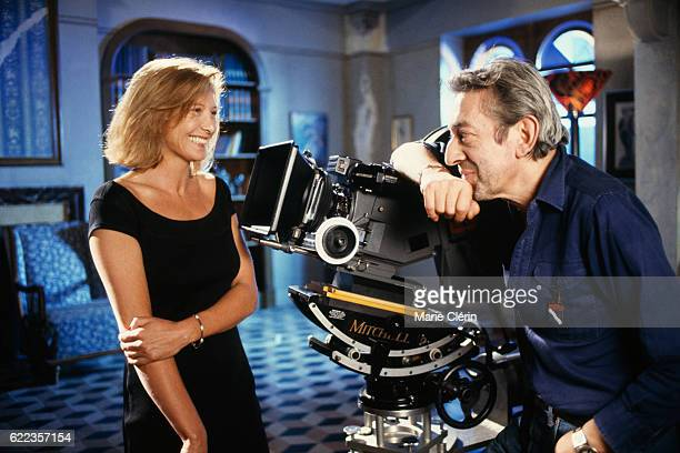French singer songwriter screenwriter actor and director Serge Gainsbourg and actress Aurore Clement on the set of his film Stan the Flasher