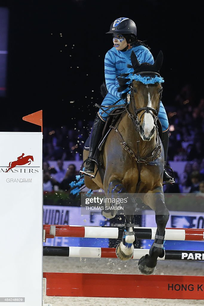 French singer Sophie Tapie competes during the Style and Competition for Amade charity costumed event of the Paris Masters equestrian jumping competition on December 7, 2013 at the Parc des Expositions in Villepinte, north of Paris.
