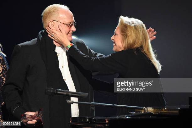 French singer Veronique Sanson look at French singer and composer William Sheller speaking after he received a special honour during the 31st...