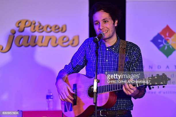 French singer Vianney sings for children during the launch of the 28th edition of the 'Pieces Jaunes' collection operation at the Necker Hospital in...