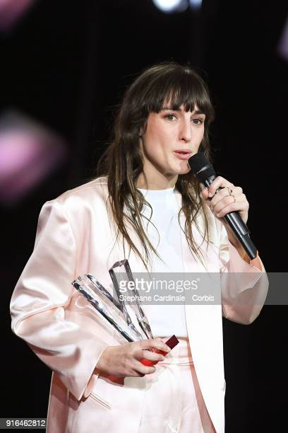 French Singeringer Juliette Armanet delivers a speech after she received the best newcomer album award as she stands next to French Tv host Daphne...