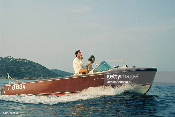 French singers and composers Michel Polnareff and Gilbert Bécaud on a 'Riva' speedboat during their summer holidays