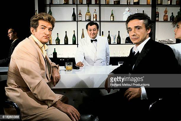 French singers Eddy Mitchell and Michel Sardou join comedian Coluche on the set of the television program Show Sardou