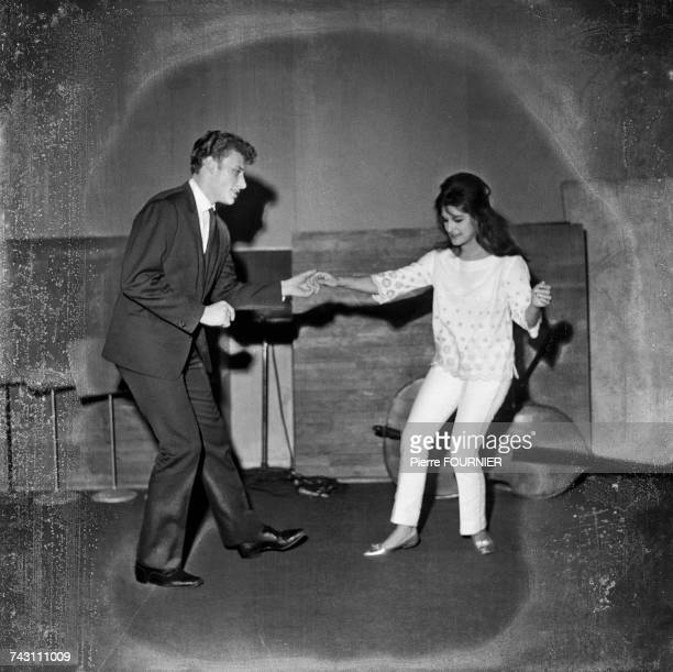 French singers Johnny Hallyday and Dalida dance the twist, 6th, December 1961.